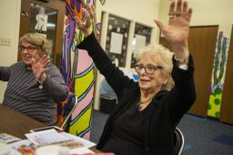 """Maryanne Burke (left), of North Riverside, and Cathy McMahon, of Oak Park, get moving in between games of bingo during the North Riverside Library's """"Bingocize"""" program for senior citizens on Feb. 20, which combines bingo with some low-impact exercise.   Alexa Rogals/Staff Photographer"""