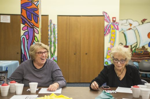 """Maryanne Burke, left, of North Riverside, and Cathy McMahon, of Oak Park, wait for numbers to be called on Feb. 20, during """"Bingocize"""" at the North Riverside Public Library.   ALEXA ROGALS/Staff Photographer"""