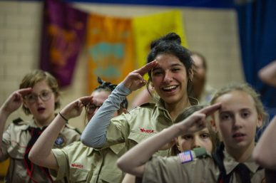 Joanna Vera, 16, salutes along with other members of the all-girl Troop 90 GT of Scouts BSA during Troop 90's meeting Feb. 27 at Brook Park School in LaGrange Park. The local Boy Scout troop is one of the first in the area to welcome girls into the fold. | Alexa Rogals/Staff Photographer