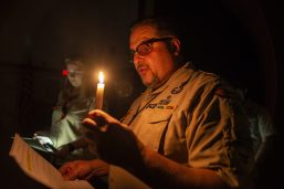 Scoutmaster Ken Knasiak reads off the oath on Feb. 27, during an induction ceremony for the Boy Scouts of America Troop 90GT at Brook Park Elementary School in La Grange Park. | ALEXA ROGALS/Staff Photographer