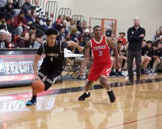 Fenwick senior guard Solomon Oraegbu stabilized the Friars talented but young backcourt with his experience and ability. (Photo by @scotchindian)