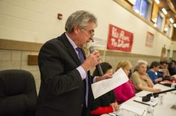 Candidate Vito Campanile answers a question submitted from an audience member on Wednesday, March 20, 2019, during a District 103 candidate forum at George Washington Middle School in Lyons, Ill.   ALEXA ROGALS/Staff Photographer