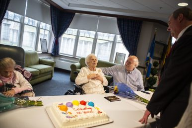 North Riverside Mayor Hubert Hermanek Jr. (right) handed out keys to the village on March 21 to four residents at Caledonia Senior Living who all are 100 years old or older and celebrated the milestones with a birthday cake. Above, Gladys Strunfield and her son, Bob, share some thoughts with Hermanek. | Alexa Rogals/Staff Photographer