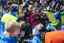 Kids scoop up Easter eggs as fast as they can during the annual Easter Egg Hunt hosted by Riverside Parks and Rec at Big Ball Park on April 13.   Alexa Rogals/Staff Photographer