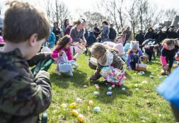 Kids scoop up Easter eggs as fast as they can during the annual Easter Egg Hunt hosted by Riverside Parks and Rec at Big Ball Park on April 13. | Alexa Rogals/Staff Photographer