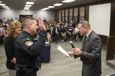 Outgoing Brookfield police chief Jim Episcopo, right, swears in the new police chief, Ed Petrak, on April 22, during a village board meeting at Brookfield Village Hall. | ALEXA ROGALS/Staff Photographer