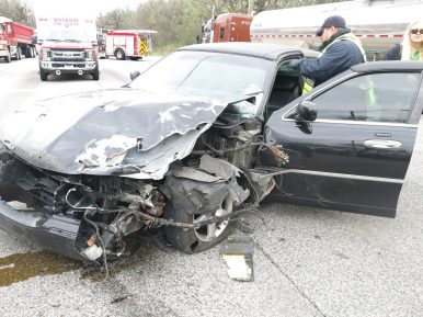 The driver of this 2001 Lincoln escaped injury after the vehicle was pushed into oncoming traffic by a semi-tractor trailer (seen in the background) while trying to change lance on the morning of April 23. (Photo courtesy of the Riverside Police Department)