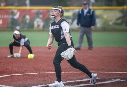 Fenwick's Gianna Amundsen throws a pitch against area rival Trinity. The Friars won 9-3 at Triton College on April 25. (Alexa Rogals/Staff Photographer)
