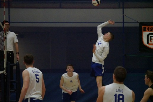 DJ Degand makes contact with the ball during the Bulldogs' nonconference match against area rival OPRF in Oak Park. (Carol Dunning/Staff Photographer)