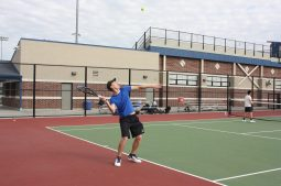 Junior Rokas Lukosevicius hits a serve during doubles play. (Courtesy of Sandy Briolat)