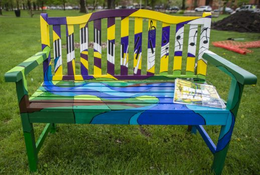 Painted benches are seen scattered through the park and near the water tower on Thursday, May 9, 2019, at Guthrie Park in Riverside. | Alexa Rogals/Staff Photographer