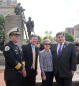Joan Labak (second from right), the daughter of John Furstoss, was joined in Springfield on May 14 by Riverside Fire Chief Matthew Buckley, state Rep. Michael Zalewski and Gov. J.B. Pritzker at the Illinois Fallen Firefighter Memorial, where a memorial brick has been placed in honor of Furstoss, who died shortly after fighting a fire in 1958. He operated a grocery store at 28 E. Burlington St. at the time.