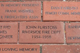 The memorial brick that was placed in honor of Furstoss.