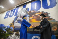 Graduates walk across the stage to receive their diploma on Friday, May 24, during the class of 2019 commencement inside the gymnasium at Riverside Brookfield High School in Riverside.   Alexa Rogals/Staff Photographer