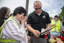 Job well done: Brookfield Police Detective Brian Jelinek (top, right) presents a plaque to Mary Morrill, recognizing her 37 years of service as a crossing guard on her final day on the job, June 5.   Photo by Alexa Rogals/ Staff Photographer