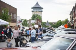 Attendees check out the parked show cars on Thursday, June 20, 2019, at the first night of the Cruise Nights event in downtown Riverside, Ill. | ALEXA ROGALS/Staff Photographer