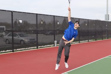 RBHS tennis player William Dowling, who plays singles and doubles, hits a serve. (File photo)