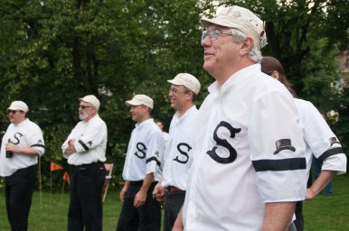 Members of the Chicago Salmon, a baseball team that plays by rules used during the 1860s, prepare to play the Deep River Grinders of Lake County, Indiana, during a special exhibition game in Big Ball Park on July 21, in conjunction with Riverside's year-long 150th birthday celebration. (Shanel Romain/Contributor)