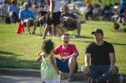 Attendees cheer on the live music on Saturday, July 27 during the North Riverside village block party in front of Village Commons on Des Plaines Avenue in North Riverside, Ill (ALEXA ROGALS/Staff Photographer)