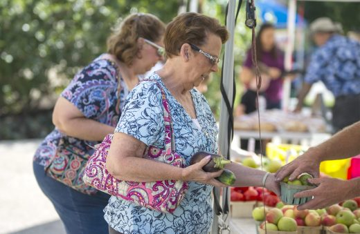 While there was still plenty of summer fruit and sweet corn, signs of fall crept into the selections at the Riverside Farmers Market on Aug. 28, with apples and pears making appearances. (Alexa Rogals/Staff Photographer)