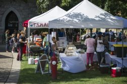 Attendees are seen buying food on Wednesday, Aug. 28, during the Riverside Farmers Market near the water tower in downtown Riverside. (ALEXA ROGALS/Staff Photographer)