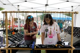 Michelle Robbins, of Westchester, and Pandora Slawinski, of Lyons, look at the jewelry available at the Elevated Gems booth on Sept. 21 at the Brookfield Fine Arts Festival in Kiwanis Park.