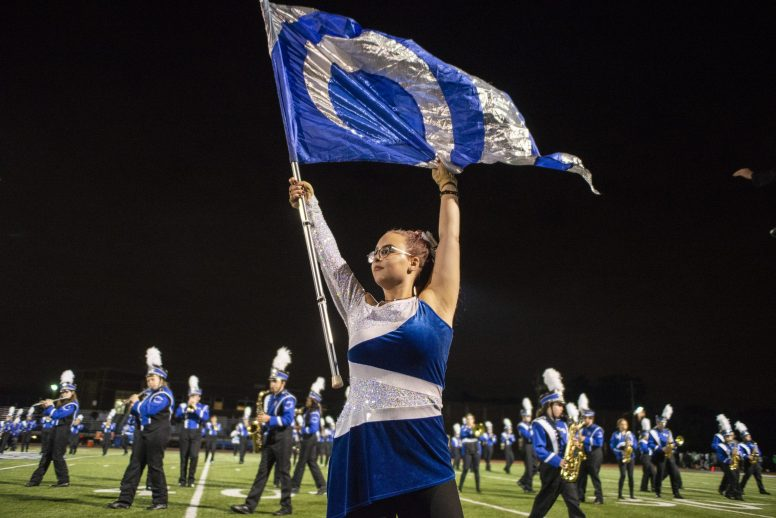 The Riverside-Brookfield High School color guard and marching band halftime performance were the icing on a homecoming cake that featured the Bulldogs' football team routing Ridgewood 43-0. (Alex Rogals/Staff Photographer)