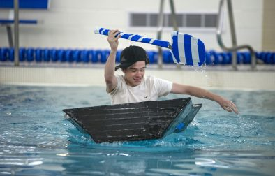 """Tyler Monahan piloted his team's boat across the RBHS pool and back to win the seventh-period physics class race. """"I honestly thought I was going to drown, but it was very exciting,"""" Monahan said. (Alex Rogals/Staff Photographer)"""