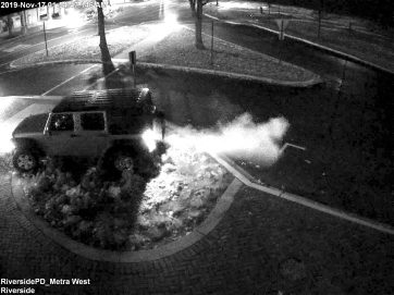 Surveillance cameras captured video of a Berwyn man driving his Jeep the wrong way down Bloomingbank Road and over a tree in a ground level planting bed next to the train station before driving on the sidewalk along Longcommon Road. (Courtesy of the Riverside Police Department)