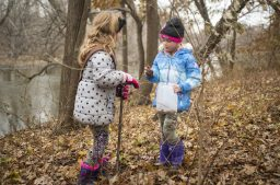 Claire Quilty, left, 6, and Adelynn Lesniak, 7, look at the seeds they are planting on Saturday, Nov. 23, 2019, during the 13th Annual 1000 Tree Planting Project in Riverside, Ill. | ALEX ROGALS/Staff Photographer