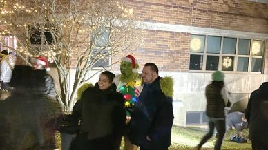 The Grinch prowled the North Riverside Village Commons grounds during the tree-lighting ceremony on Dec. 4, demanding photos be taken with him. Dozens gladly obliged. (Bob Uphues/Editor)