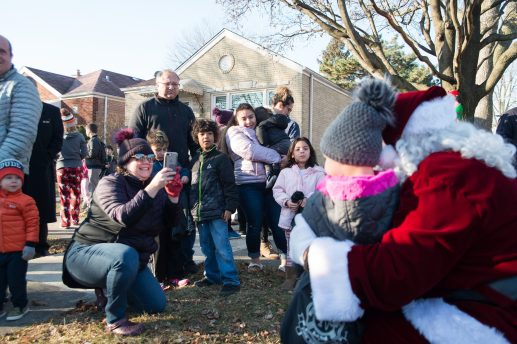 Dozens of families were greeted with sirens and Santa Clause throughout North Riverside. | SHANEL ROMAIN/Contributor
