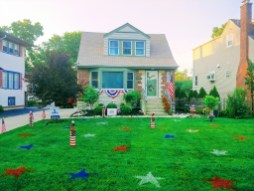 Receiving an award for decorating their homes and blocks for the Riverside July 4 parade were the Duff family for Most Decorated Yard.
