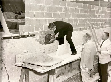 Rev. John C. Talbot places the time capsule in position behind the cornerstone of Community Presbyterian Church on Aug. 18, 1957 as other church officials look on. (PROVIDED)
