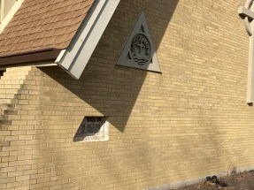 A hole in the wall of the church's front facade indicates where the time capsule had been located. (Bob Uphues/Editor)