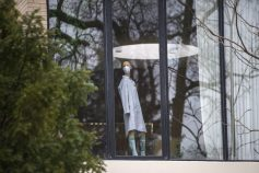 A mannequin sporting a surgical mask, a symbol of life under COVID-19 lockdown, stands sentinel in the front window of a home in the 300 block of Fairbank Road in late March. (Alex Rogals/Staff Photographer)