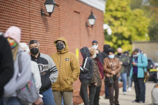 As the first day of early voting dawned in the Cook County suburbs on Oct. 19, voters lined up around the building at Brookfield Village Hall, waiting as long as two hours to cast their ballots. (Alex Rogals/Staff Photographer)