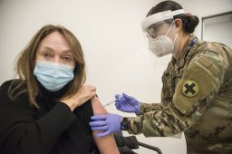 Patricia Golden receives her first dose of the COVID-19 vaccine from Illinois National Guard Spec. Lynnette Banuelos on Jan. 22 at Cook County Health's North Riverside Clinic on Harlem Avenue. The site is one of 13 recently opened county vaccination centers. (Alex Rogals/Staff Photographer)