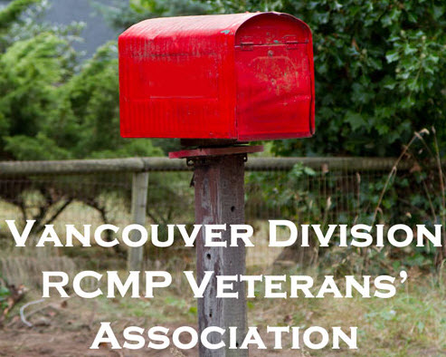 Photograph of red mail box and the label for the Vancouver Division