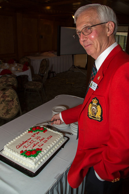 Photograph of the 80th anniversary cake being cut by President Keith Leishman of the Vancouver Division of the RCMP Veterans' Association (Source of photo - Sheldon Boles).