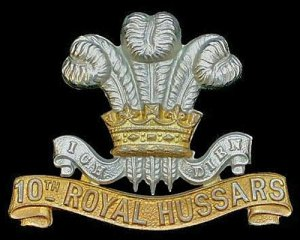 Photograph of 10th Royal Hussars cap badge