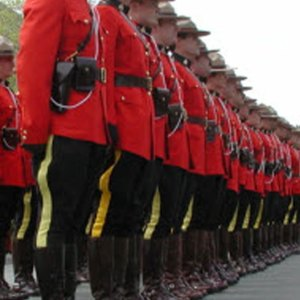 Photograph of RCMP members in red serge.