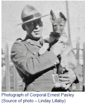 Photograph of RCMPCpl.  Ernest Pasley holding a pup