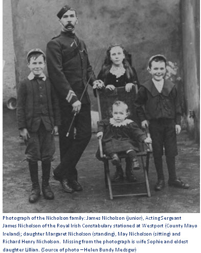 Photograph of Acting Sergeant James Nicholson of the Royal Irish Constabulary and his family.