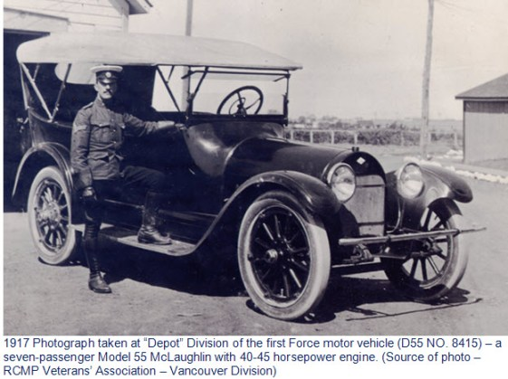 Photograph of RNWMP members standing beside the first Force police vehicle