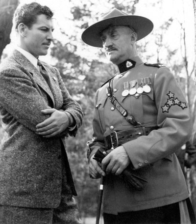 """1940 - Photograph of Actor Preston Foster (who played Sergeant Jim Britt in the North-West Mounted Police movie) and C/S/M Tim Griffin (Source of photo - RCMP Historical Collections Unit - """"Depot"""" Division)"""