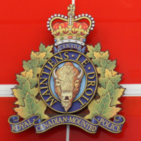 """Photograph of the RCMP Crest at the front entrance to the new """"E"""" Division headquarters complex"""