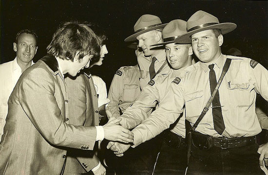 1964 Vancouver, BC - Photograph of the Beatles shaking hands with uniformed RCMP members (Source of photo - Ric Hall's Photo Collection)