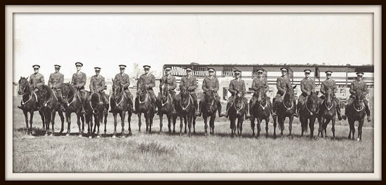 """Photograph of an unknown Troop of recruits at """"Depot"""" Division. The new riding school being is in the background. Noted building was constructed in 1953. (Source of photo - George Cutting photo collection)"""