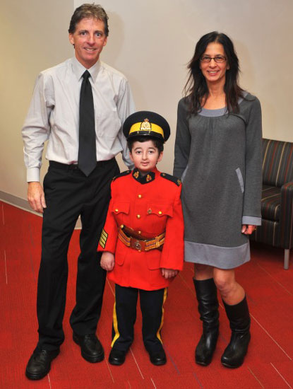 Photograph of Larry and Kim with their son - Casey Wright wearing an RCMP uniform (Source of photo - Kim Wright)